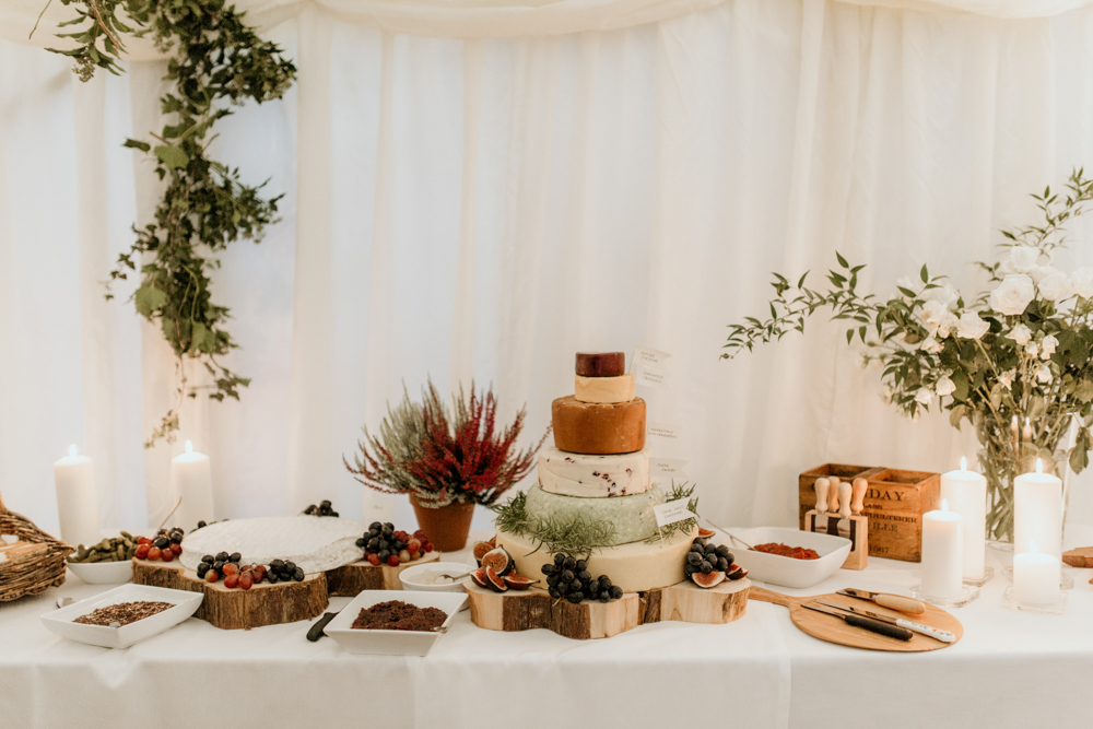 cheese wedding cake and fruits during a Poulton wedding