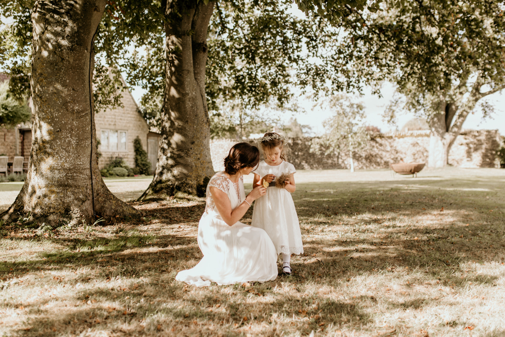 bride with flower girl in the garden at Poulton