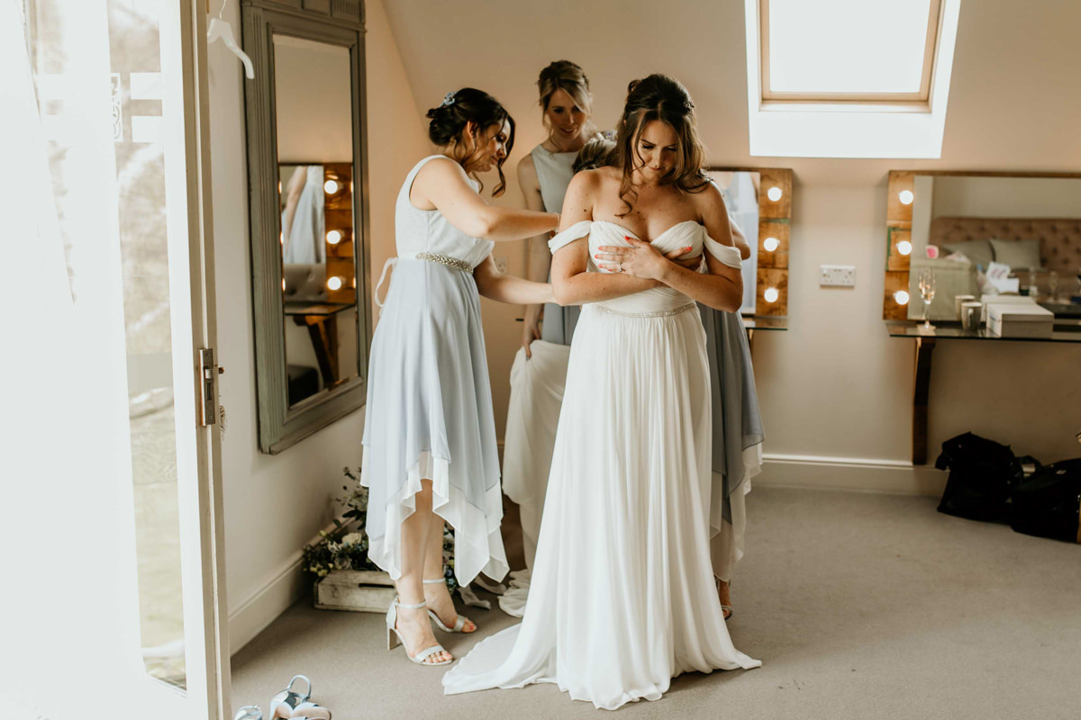 bride an bridesmaids in hyde house