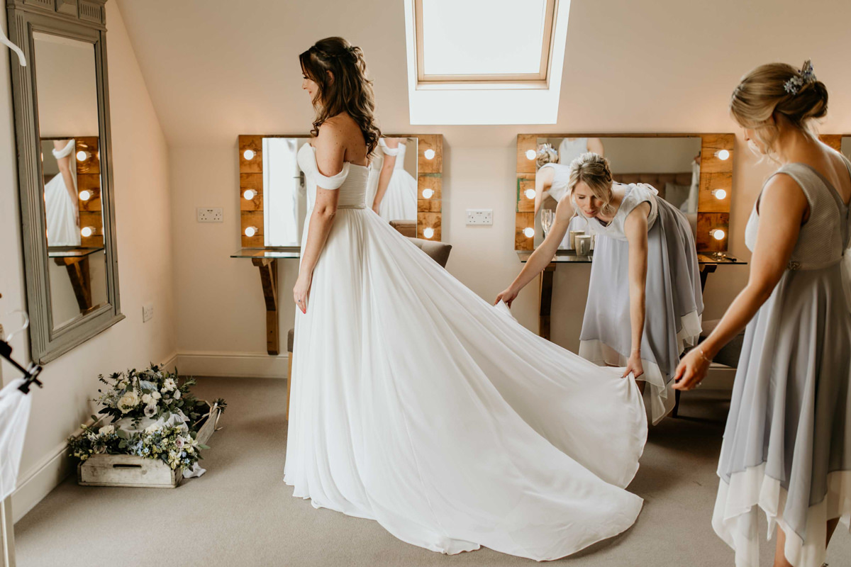 bride getting her wedding dress on at hyde house in the cotswolds