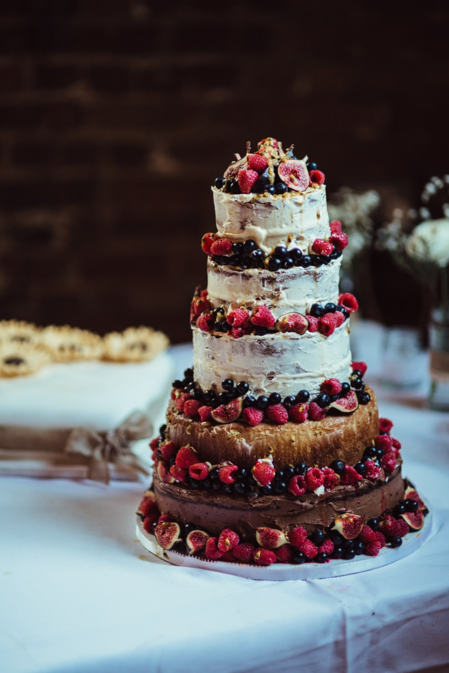 homemade naked cake with lots of berries