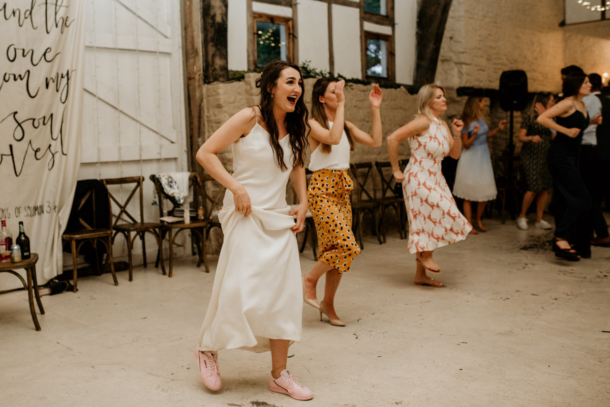 bride dancing during the reception at Priors Court Barn
