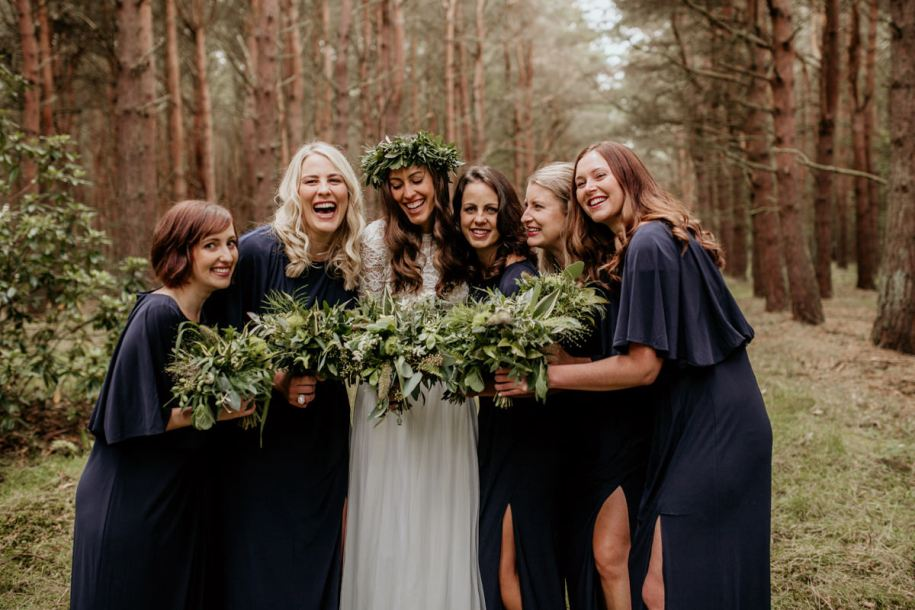bridesmaids and bride during standard family group shots for a forest wedding
