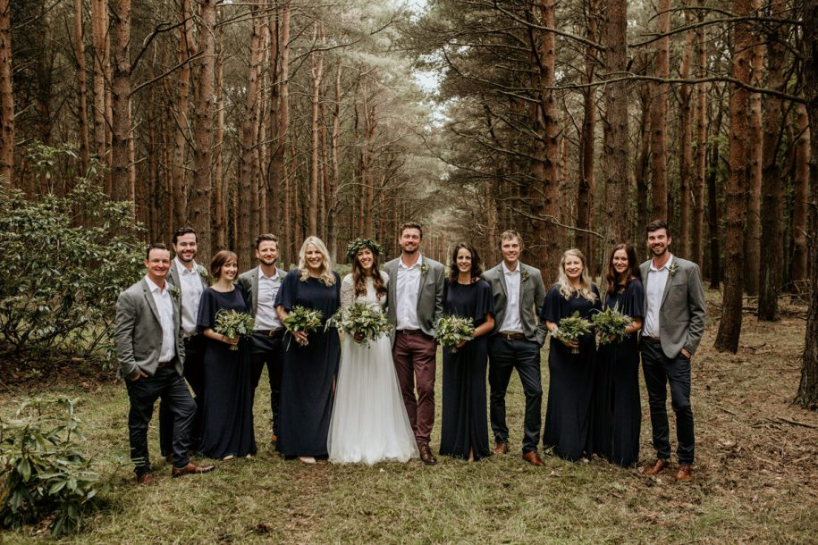 bridesmaids and groomsmen during family group shots for a forest wedding