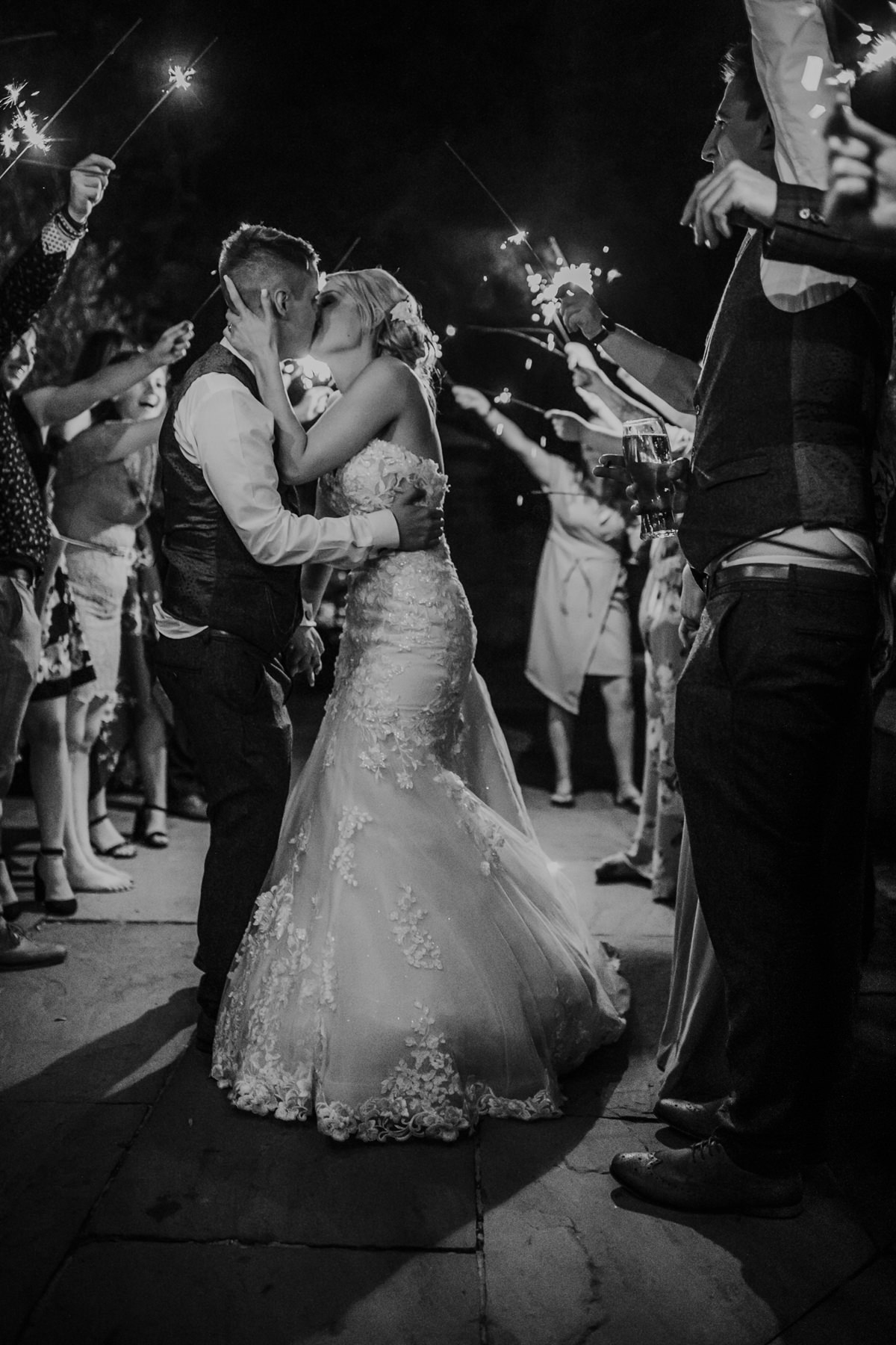 bride and groom kiss during the sparklers shot at Shustoke Barn wedding venue