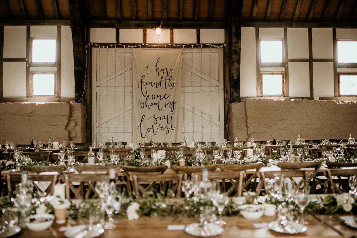 wedding setting at priors court barn wedding venue