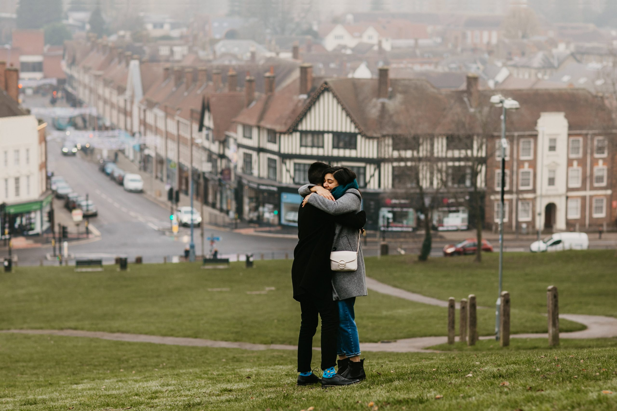 couple hugging after she said yes during the proposal shoot