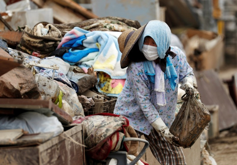 اليابان تكافح لإعادة إمدادات المياه إلى بلدات اجتاحتها سيول