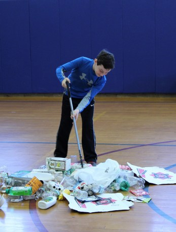"A student sorting items from ""Trash Mountain."""