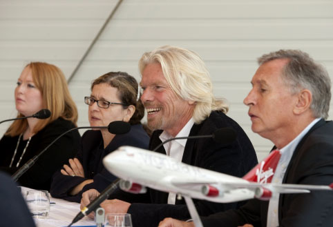 Richard Branson, with LanzaTech's Jennifer Holmgren, talking about jet fuel made from waste carbon gases