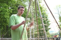 Grant became a real pro at weaving the twine for the pea tendrils to climb on.