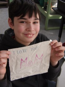 Nicky used stamps and markers to create his message.