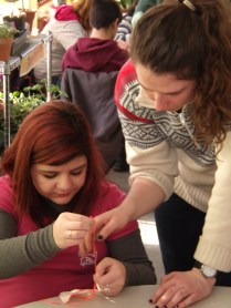 Wildlife intern Emily lends a hand to Lianna.