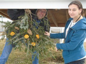 Farm director, Michael Kaufmann and Kerri hang our finished product in the farm area.