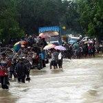 People fleeing floods