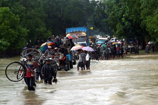People fleeing floods