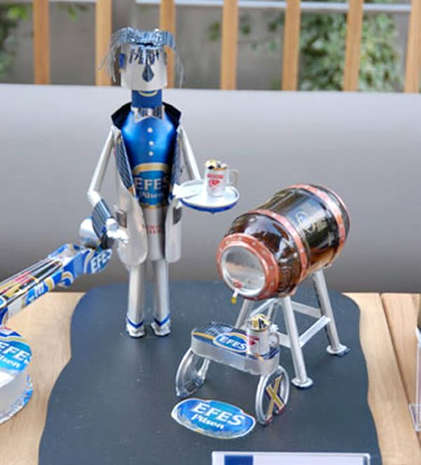 A waiter made from beer cans