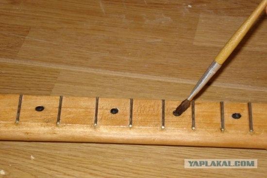 anonymous artist converts shovel into a guitar 10