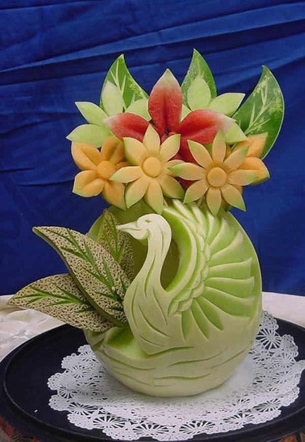 honeydew melon swan sculpture with fruit flowers