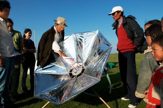 solar powered cooker and electricity generator