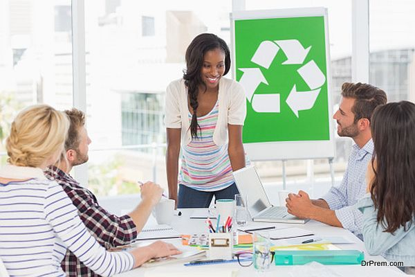 Smiling young team having a meeting about recycling policy