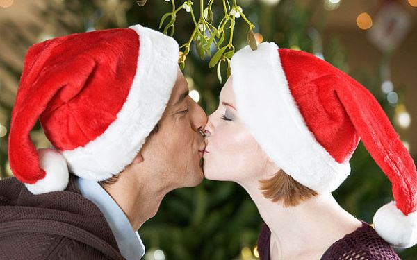 Contribute with a kiss under the mistletoe