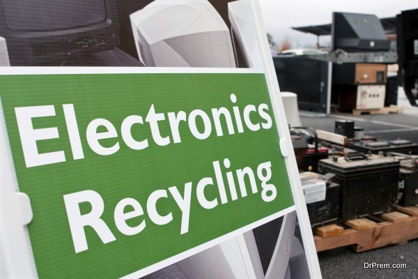 """Lawrenceville, GA, USA - November 23, 2013: An """"Electronics Recycling"""" sign marks the spot for people to drop off old computers, TV's , etc. at Gwinnett County's America Recycles Day event."""