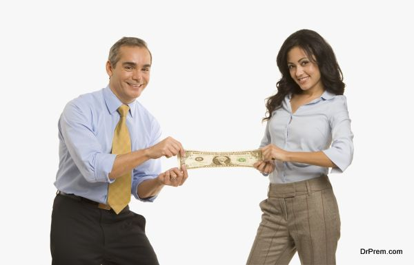 Businesspeople stretching a dollar between them
