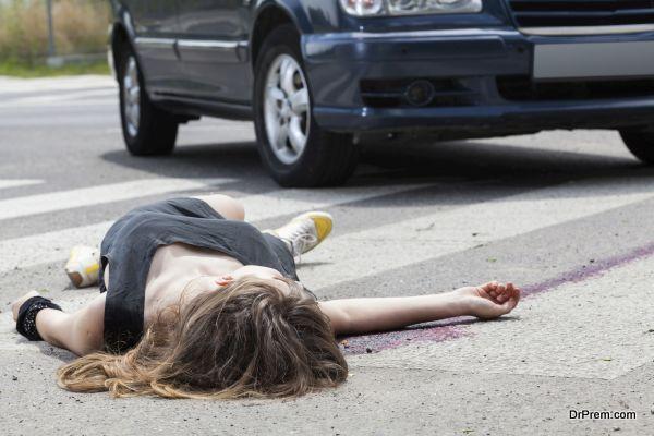 Dead woman lying on a street