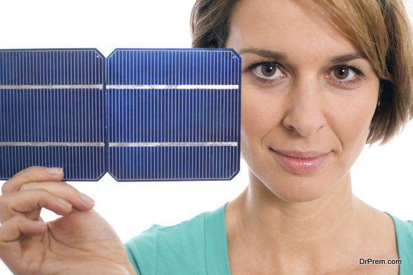 Woman holding solar panel