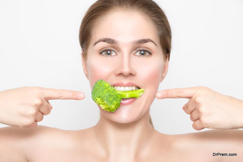Beautiful woman with broccoli