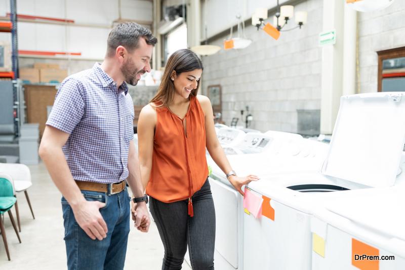 couple choosing washing machine