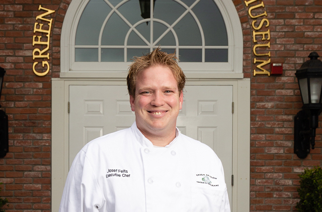 Chef Josef Felts in front of Green Dragon Tavern & Museum