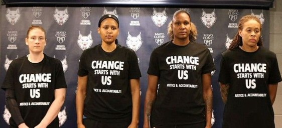 WNBA players wearing protest T-shirts