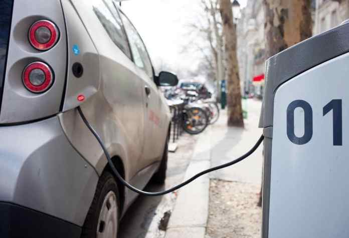 an electric car charging in France