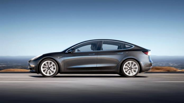 Tesla Model 3 in Dark Grey from the side