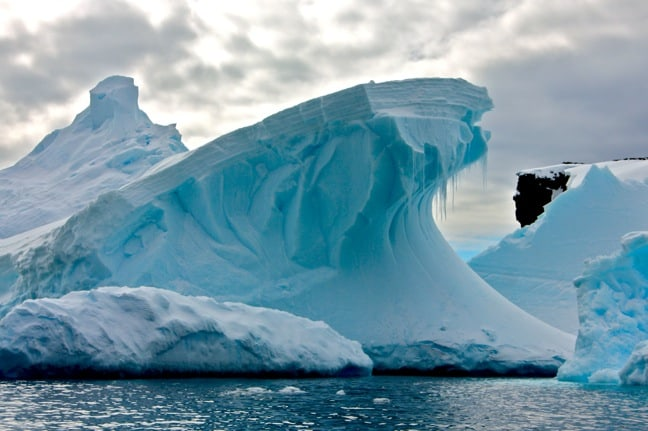 The Haunting Beauty of Icebergs in Antarctica