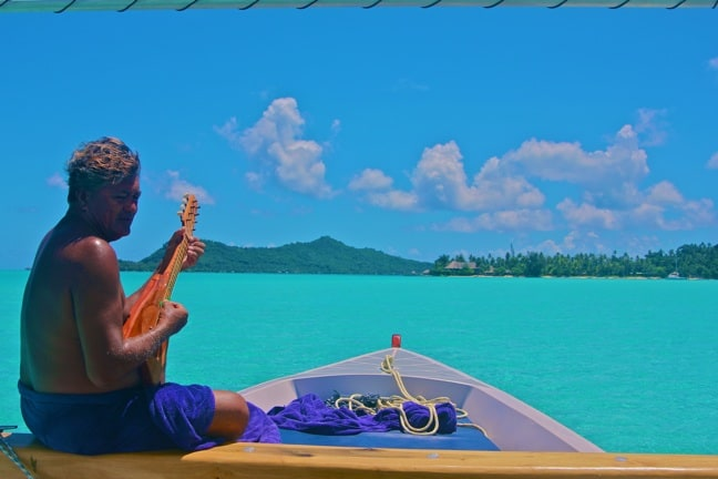 Ukelele serenade during a boat ride in Bora Bora, Tahiti