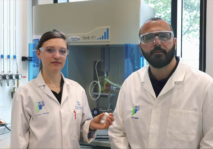 A sticky solution could improve carbon capture materials: Dr Louise Hamdy, pictured with Dr Enrico Andreoli, holds some of the new material they developed at the Energy Safety Research Institute at Swansea University.