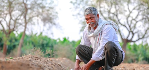 An Indian farmer checking the water pipes in his fields.