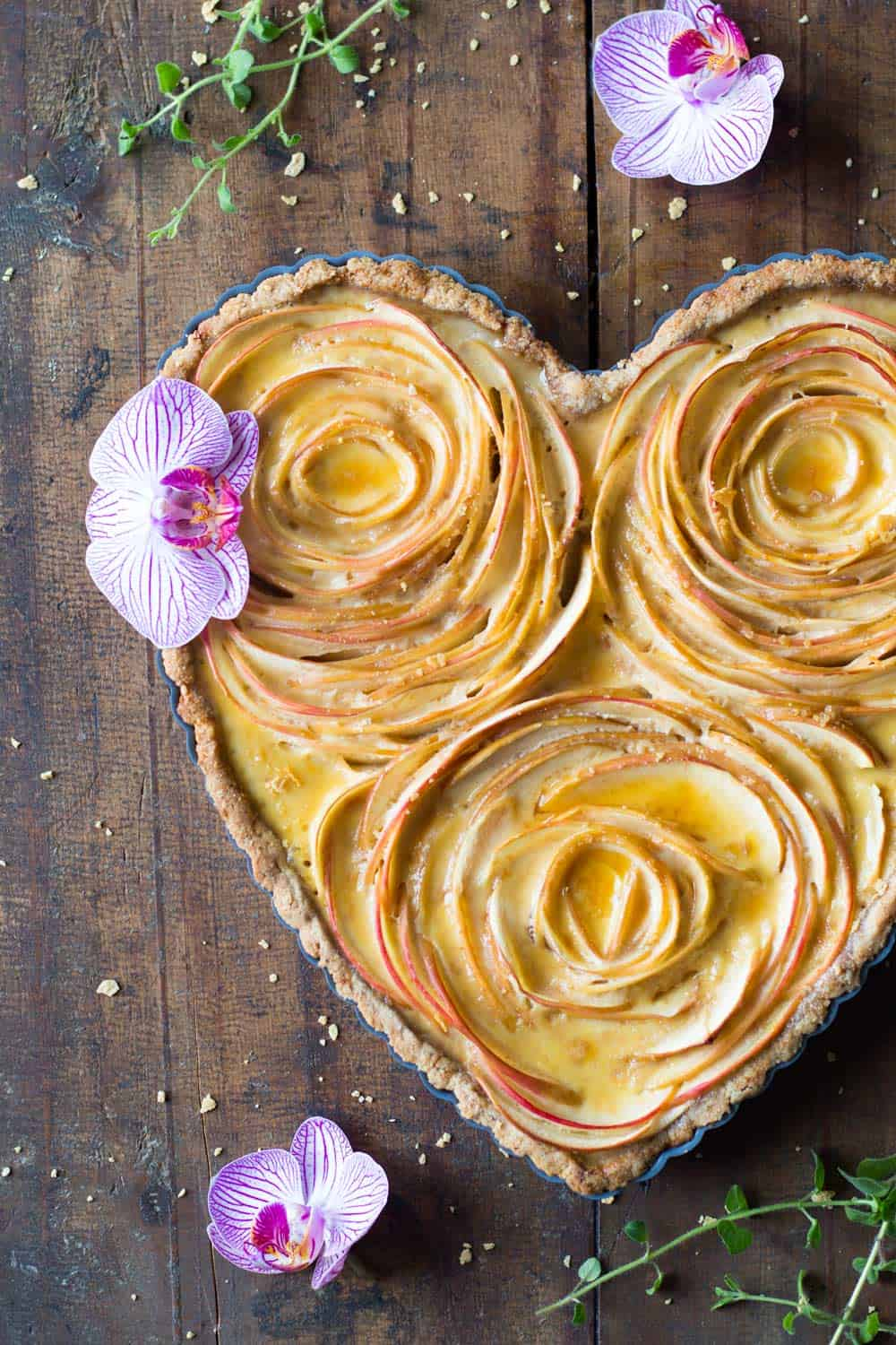 An apple rose tart that will make your loved one drop their chin! A crunchy nut crust, sweet apples and maple custard, what else can you want in life?