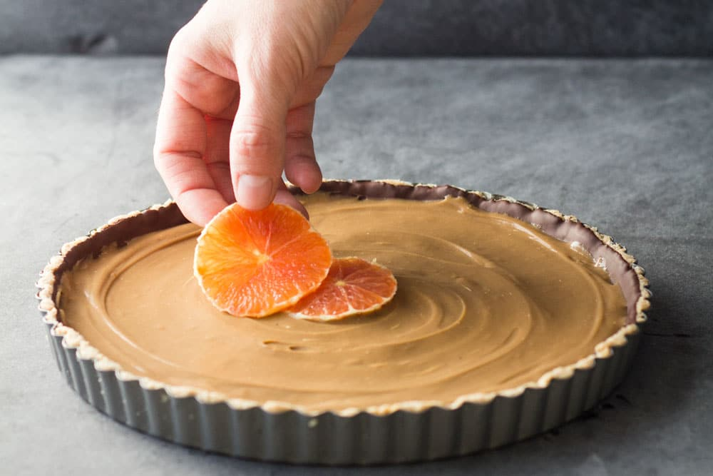 Almond meal, dark chocolate, coconut caramel and orange make the most amazing Healthy Almond Chocolate Caramel Orange Tart you could ever dream of!