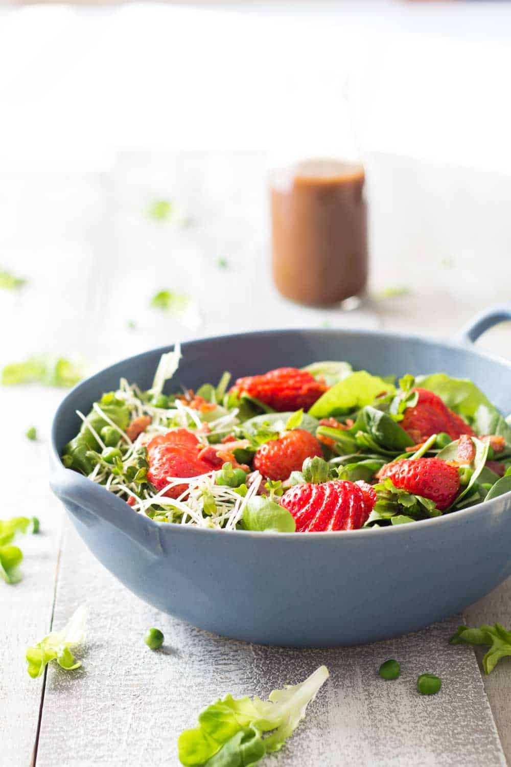 Let's pray to the spring Gods by indulging in this healthy and delicious Strawberry Bacon Spring Salad with Maple Mustard Balsamic Dressing. Yum!
