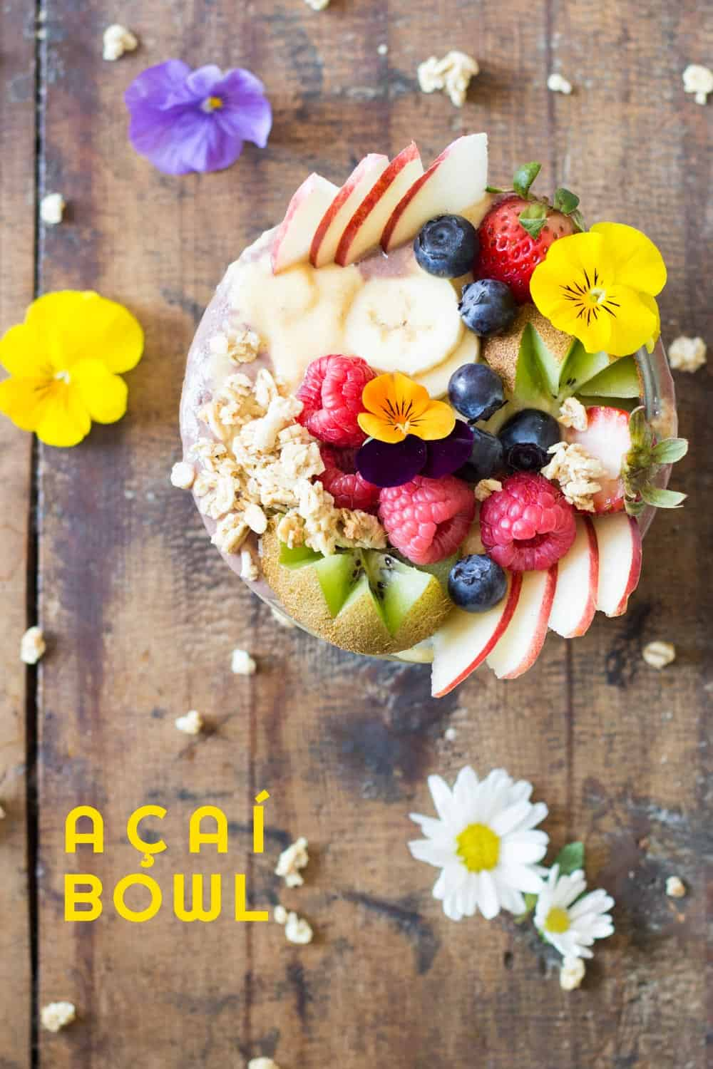 Out of this world Acai Bowl made in 10 minutes. Delicious açaí berry smoothie and sweet mango smoothie made in a blender, beautiful fresh fruit and granola.