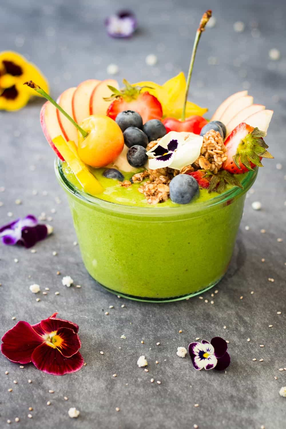 Recipe for a healthy vegan Green Smoothie Bowl full of nutrients that smells like summer. Made with frozen banana, almond milk, and baby spinach!