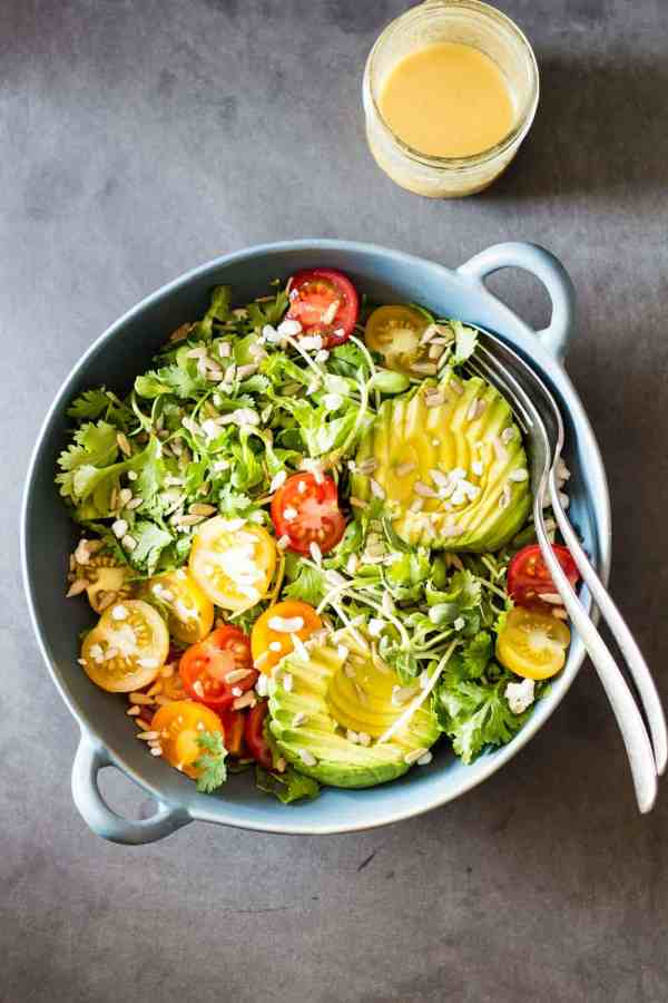 Mexican-Style Side Salad, all Mexican goodness packed into a salad. Delicious avocado, tomatoes, sunflower seeds, queso fresco and abundant fresh coriander!