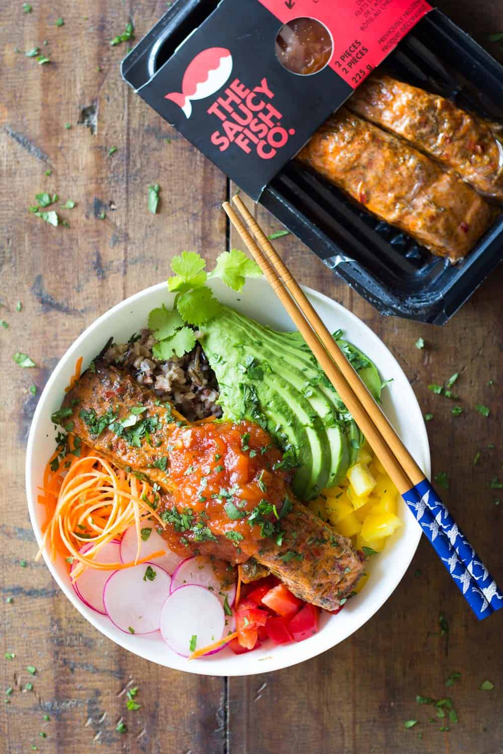 10-minute prep to-die-for Cooked Salmon Poke Bowl! Your favorite grain, chopped up veggies and a delicious salmon filet topped with the most amazing sauce!