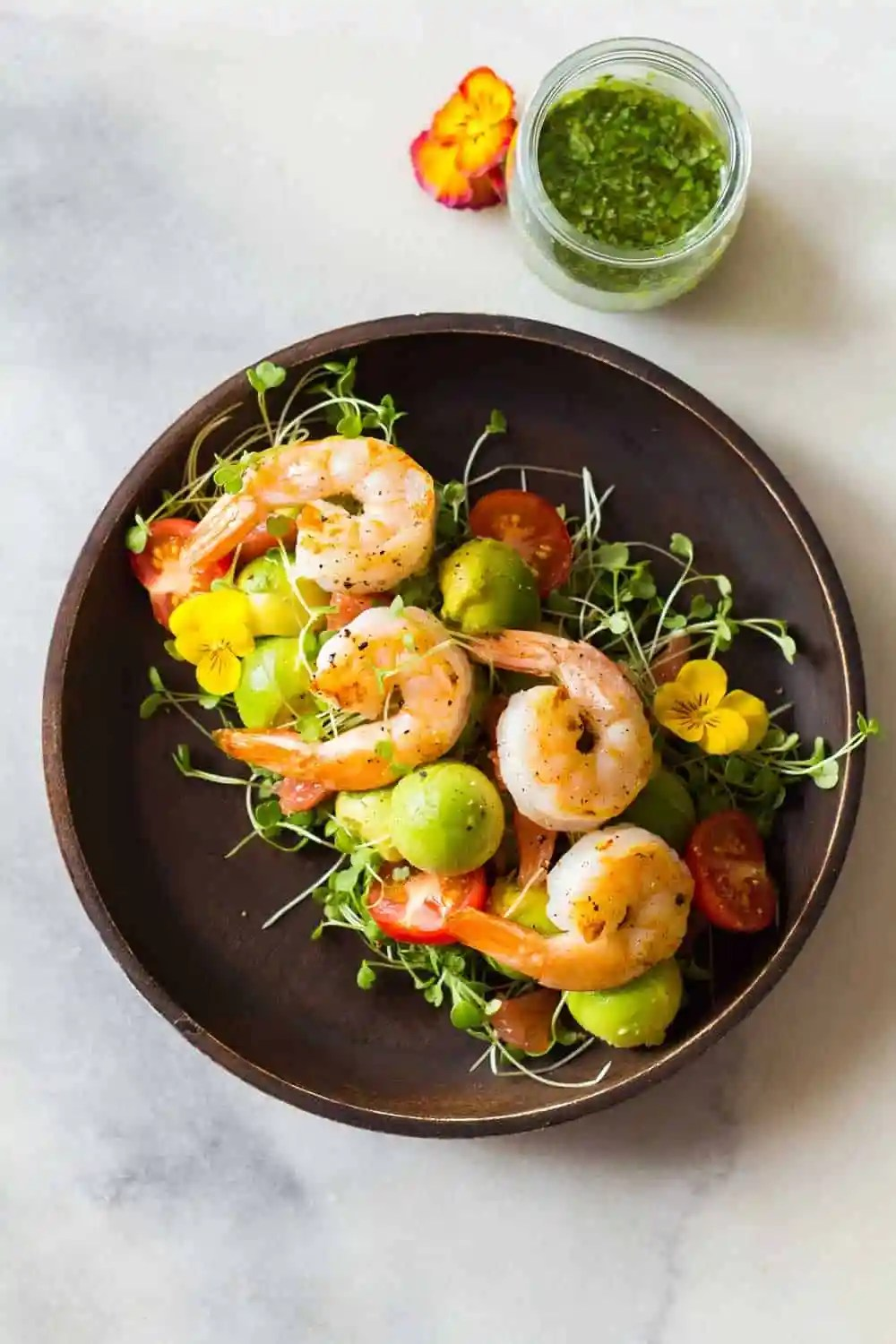 Shrimp, avocado, tomato, arugula and grapefruit with cilantro dressing. Imagine the flavor explosion when you take a bite of this Shrimp Avocado Salad!