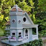 Springfield-Flower-Cottage-Birdhouse-is-a-Beautiful-Sky-Blue-with-White-Trim-Charming-Wood-Birdhouse-with-Beautiful-Flower-Pots-0