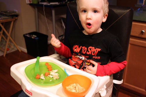 toddler eating Savory Oat Stew with Chicken and Northern Beans
